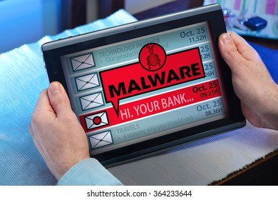 man with tablet which see emails and alert message with the word malware / hands of a man looking inbox in tablet with a malware message