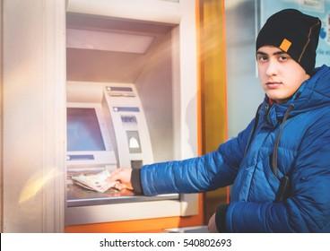 Man take money on atm