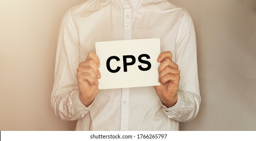 man take a paper with text CPS on the shirt with office background