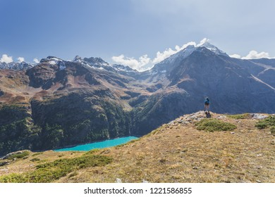 A man take a picture of Lake Place Moulin glacial reservoir, Aosta Valley, Italian Alps, Italy, Europe