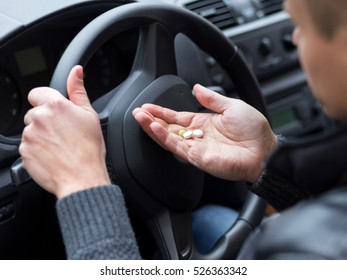 Man takes drugs in the car