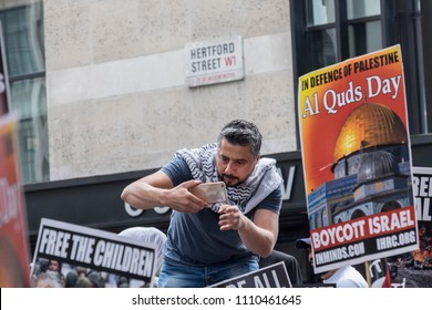 A man takes photogrpahs during the Al Quds Day rally, London, 10/06/18.