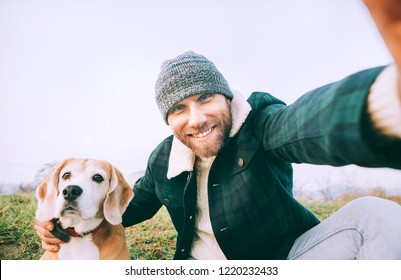 Man takes selfie photo with his best freind beagle dog