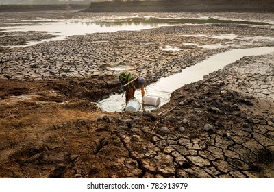 A man takes water on dry land