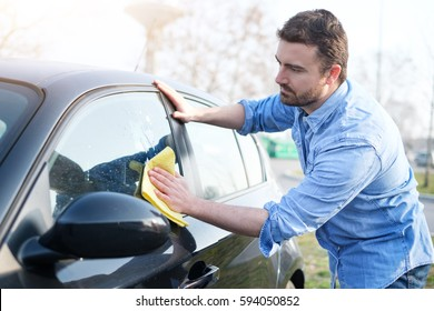Man taking care and cleaning his new car