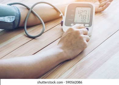 Man is taking care for health with hearth beat monitor and blood pressure