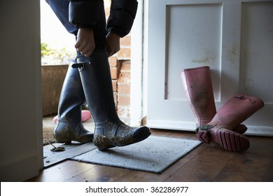 Man taking of his wellington boots