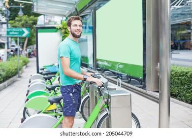 Man taking motorbike for rent