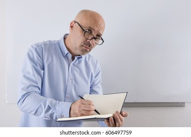 A man taking notes