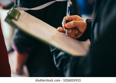 Man Taking Notes on Clipboard, Clipboard Notes,