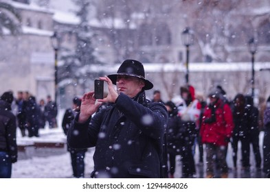 A man taking photo on a snowy day in Sultanahmet square, Istanbul, Turkey, 02.01.2016