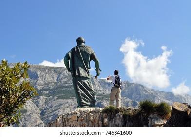 Man taking a photograph, Makarska, Croatia