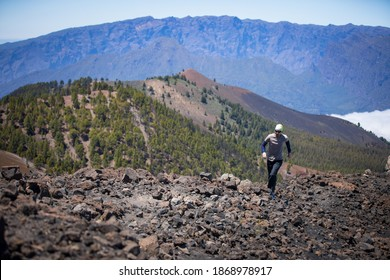 man taking photos of the beautiful nature of canary islands
