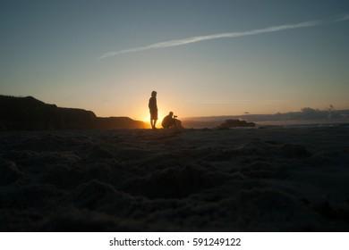 Man taking photos at golden hour in Galicia beach