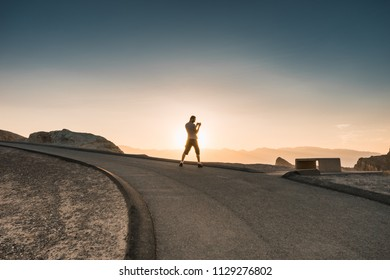 Man taking picture during sunset in the lowest point on earth in Death valley, USA, West Coast