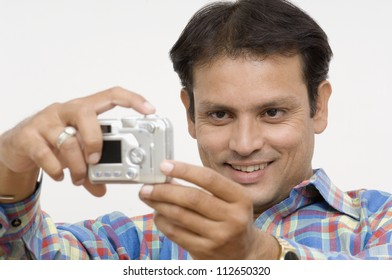 Man taking picture of himself with a digital camera