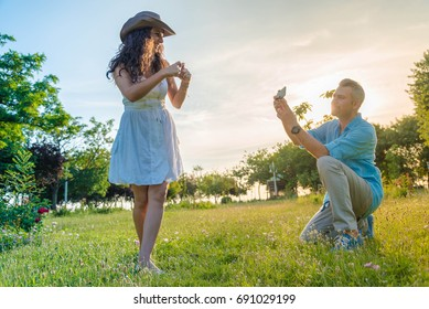Man taking picture of woman