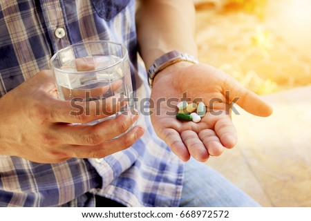 taking pills with water