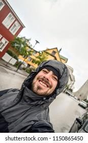Man taking a selfie in Reykjavik, Iceland on a rainy day
