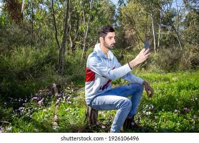 Man taking a selfie in a woods