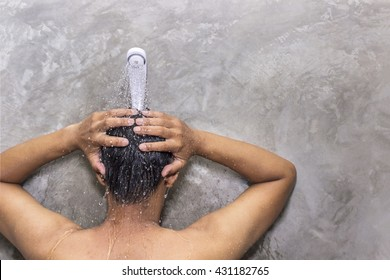 Man taking a shower to cleanse the body after tired and stressed from work.