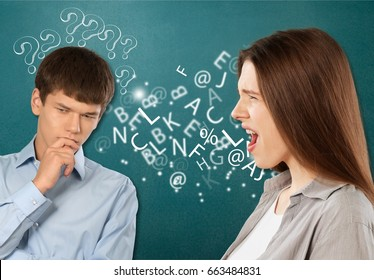 Man talking to an attractive woman with.