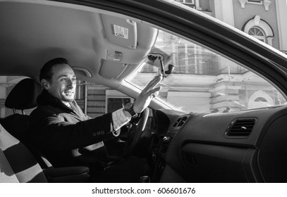 Man talking to friends from his driver sit