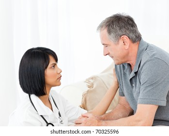 Man talking with his nurse on the sofa
