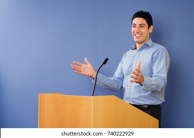 Man talking from lectern
