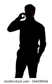 Man talking on cell phone in silhouette isolated over white background