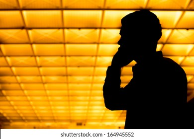 Man talking on cell phone in silhouette