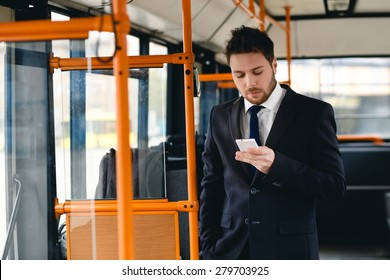 Man Talking on Cell Phone, public transportation, ride a bus
