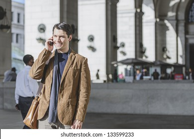 Man Talking On Cellphone At The Train Station