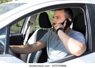 Man talking on the mobile phone while driving a car