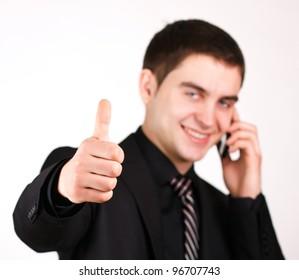 man talking on mobile phone showing thumb