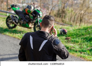 man talking on the phone to the insurance of his motorcycle after having suffered a breakdown. Emergency call of a motorist. motorcycle insurance.
