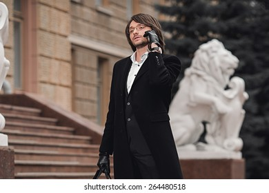 man talking on the phone outdoors