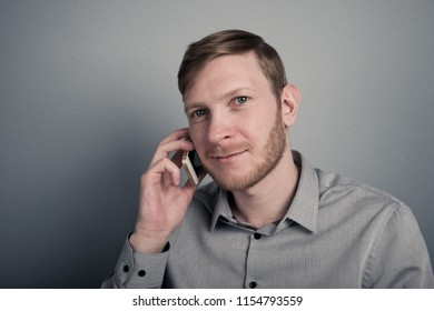 man talking on phone and smiling