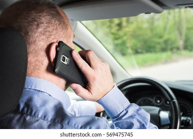 Man talking on the phone while driving