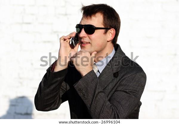 The man talks on a cellular telephone