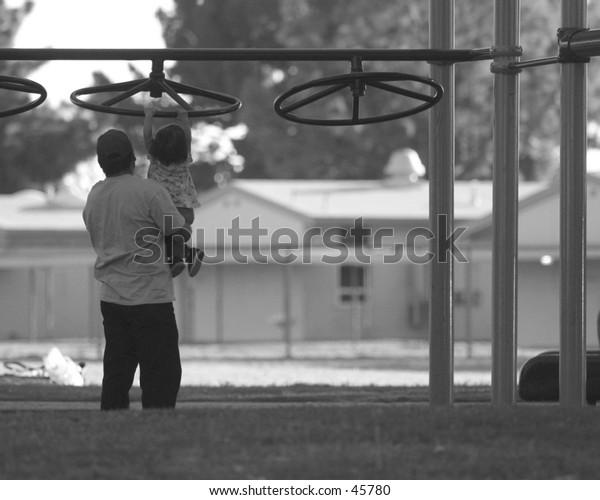 Man teaching child to reach up