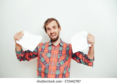 man tear paper