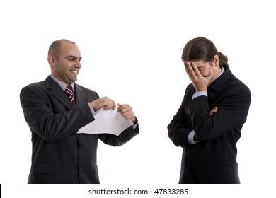 man tearing paper