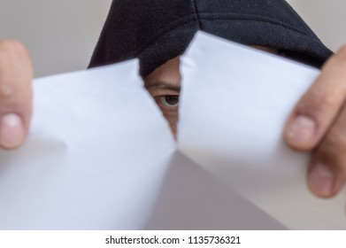 Man tearing a paper apart in two pieces
