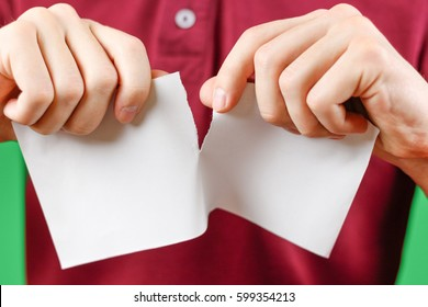 Man tearing a piece of paper in half blank white flyer brochure booklet. Leaflet presentation. Pamphlet hold hands. Male show clear offset paper. Sheet template. Booklet design sheet display