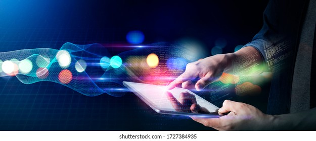 Man technology future lifestyle, digital marketing IOT internet of thing future AI technology smart device social network, man with tablet surfing internet with futuristic vibrant light background - Shutterstock ID 1727384935