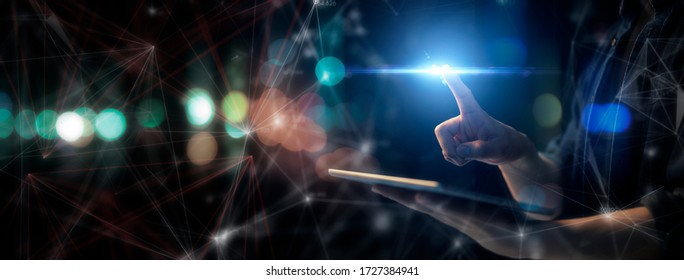 Man technology future lifestyle, digital marketing IOT internet of thing future AI technology smart device social network, man with tablet surfing internet with futuristic vibrant light background