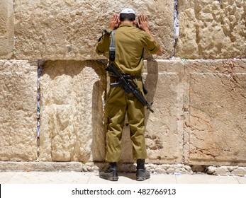 Man with tefillin praying at the Wailing Wall, Jerusalem