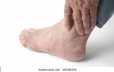 a man tends to his sore ankle