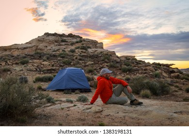 A man tent camping in the desert southwest, Utah, USA.
